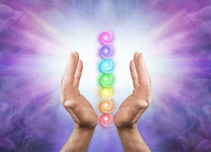 Sending You Seven Chakra Healing Energy - Male parallel hands facing upwards against a pur
