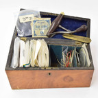 Wood string box containing strings and accessories, Gardner Houlgate.