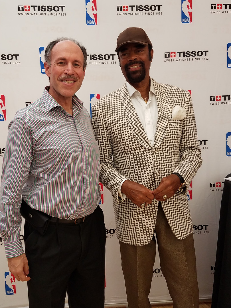 Eli with NY Knick NBA Hall of Famer Walt Frazier