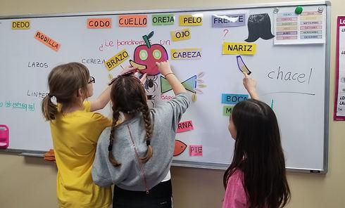 Older Kids on learning spanish on the whiteboard atat Spanish4you!