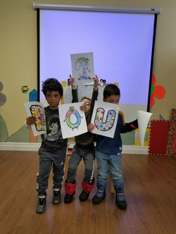 Pre-schooler displaying their art work