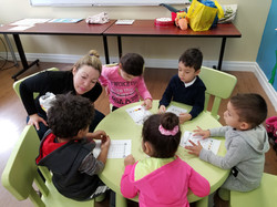 Pre-schoolers working together with teacher