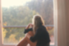 girl staring out window.jpg