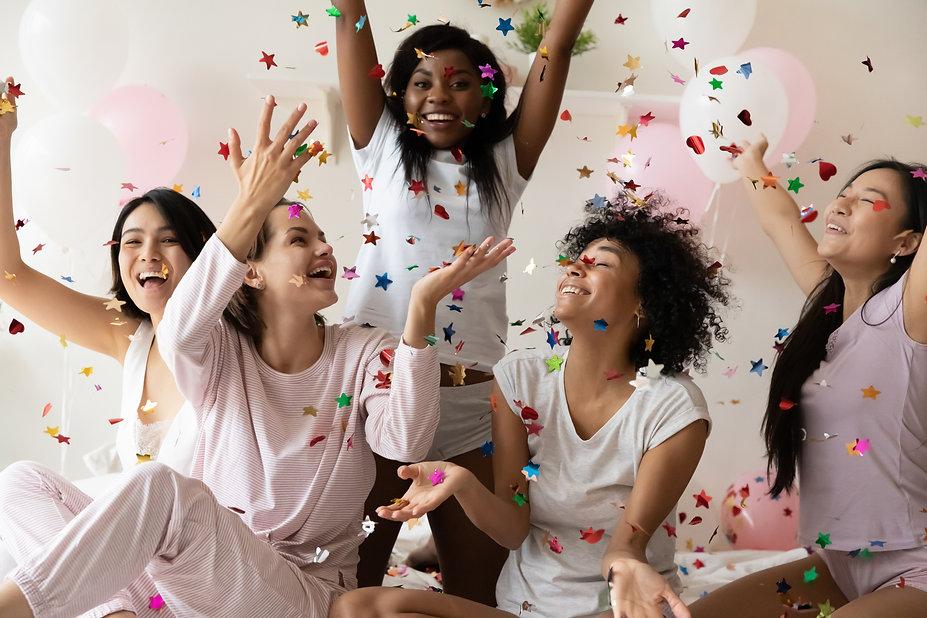 Five cheery multiracial girls laughing c