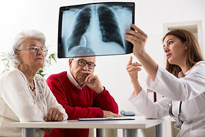 doctor-holding-up-x-ray-scan-of-lungs-in
