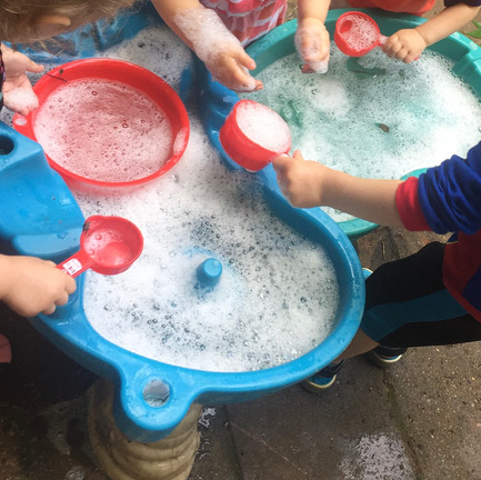Added bubbles to our water play!