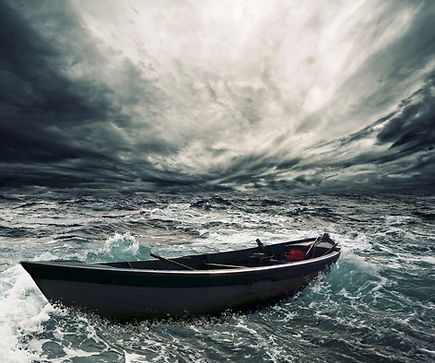 Abandoned boat in stormy sea.jpg