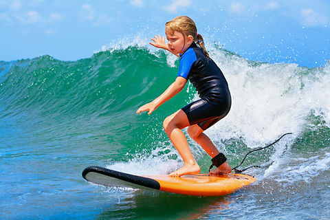 Happy baby girl - young surfer ride on s
