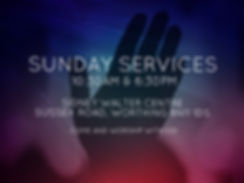 shades of purple and blue with light streams angled across the image.  A silhouette of a hand raised in worship dominates the picture