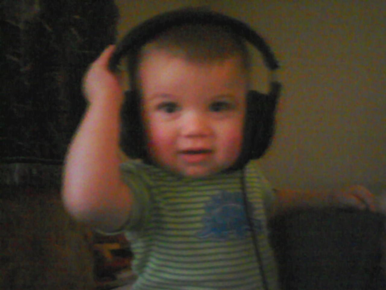 My son Landon into Daddy's stuff