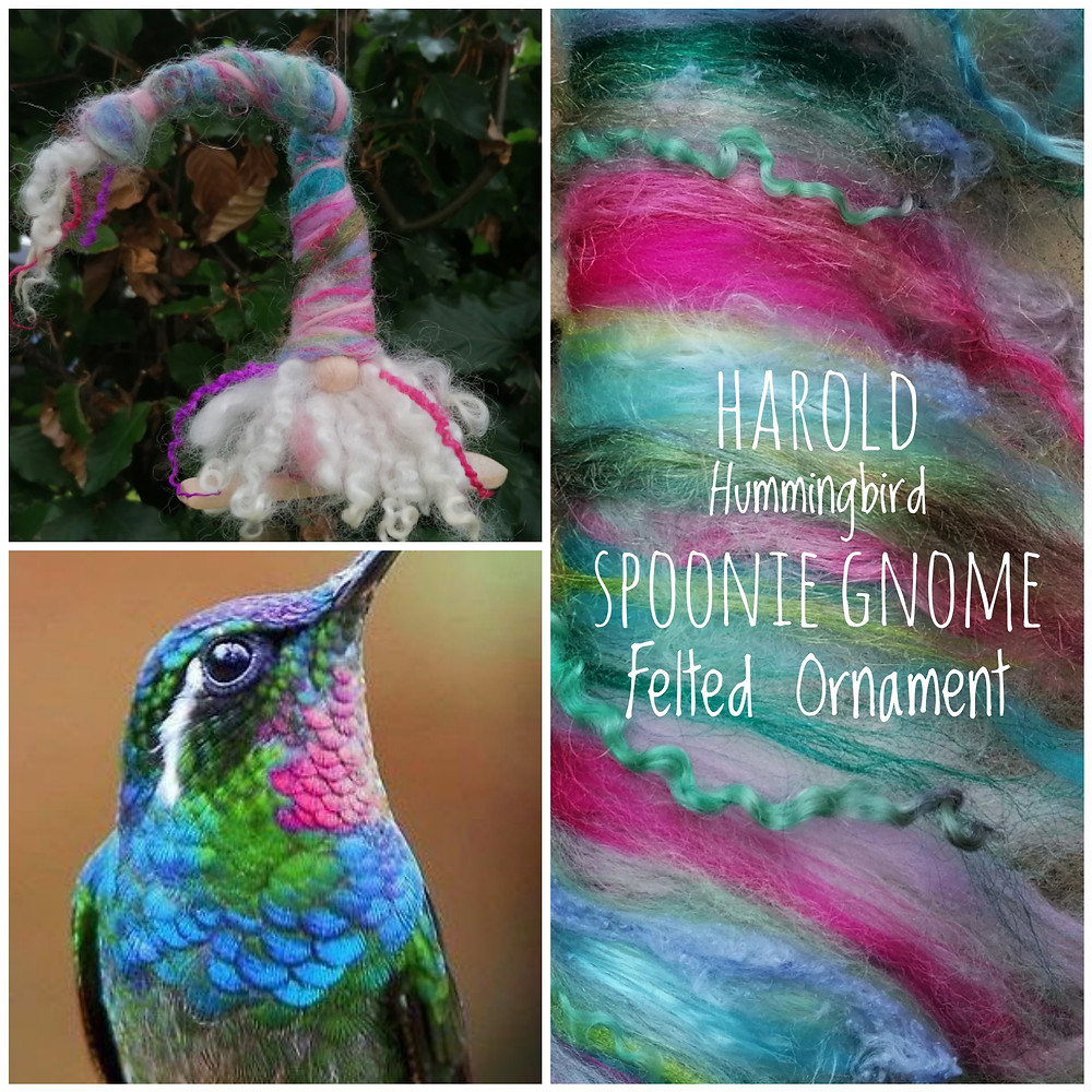 """This hand felted ornament is Harold of the Hummingbirds Spoonie Gnome.  Harold is one in a series of gnome ornaments inspired by the hummingbirds.  Everyone can use a little extra help and these felted gnome """"Spoonie"""" ornaments are there to lend you a spoon when you need it. Harold's hat is a blend of light blue, soft green and white Tencel (nettle fibre); white firestar; bright pink silk noil; leaf green, teal, maroon, and soft blue merino."""