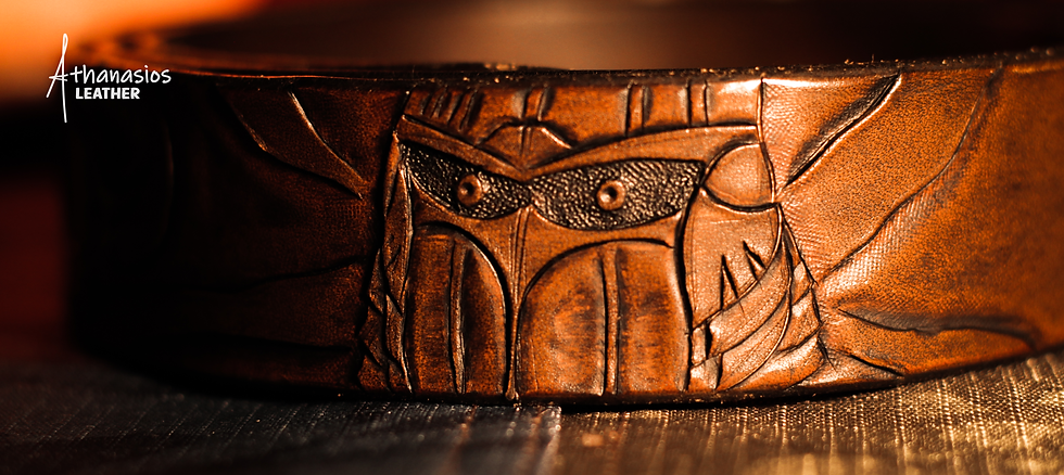 athanasios lazarou's hand tooled carved vegetable tanned leather belt with a hero knight ready to take on any dangerous creatures