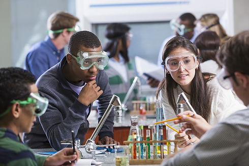 group-of-multi-ethnic-students-in-chemistry-lab-469951129-589c9db33df78c475814246a.jpg