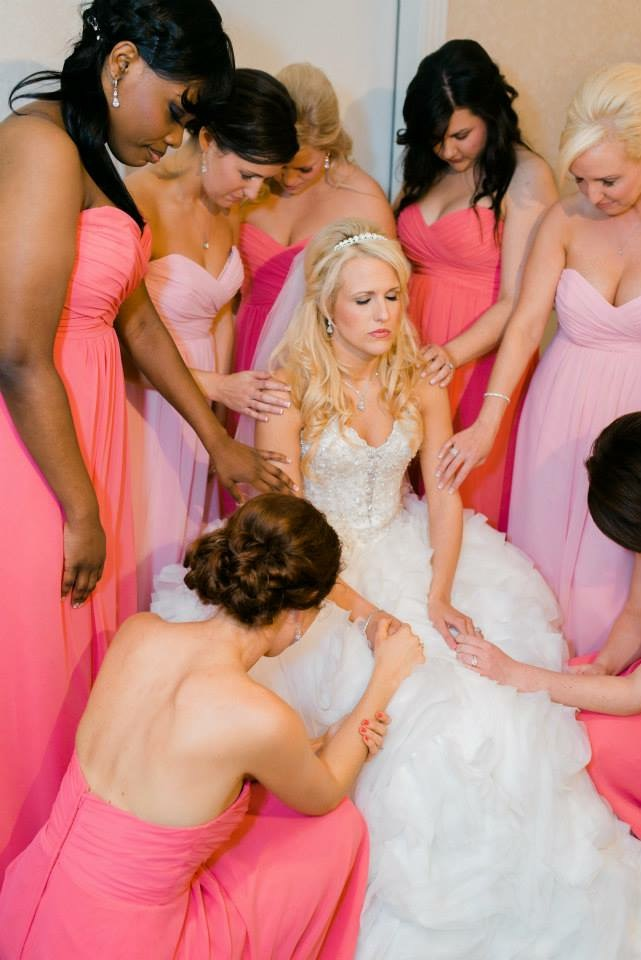 Praying with Bridesmaids
