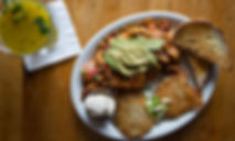 Imae of scramble with Avocado onit, toast, potato hash, and butter from the Tin Shed in Portland Oregon on Alberta Street DistrictBlock 14