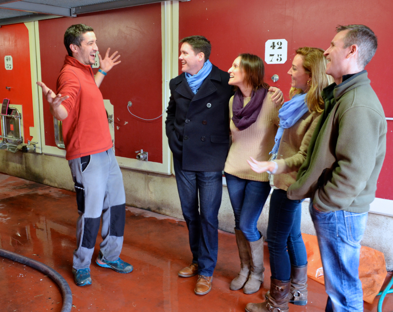 happy wine maker with clients, Rhone