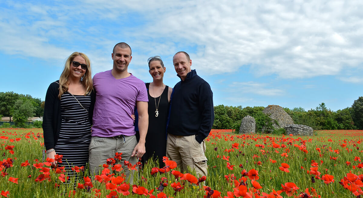 tourists in poppy field
