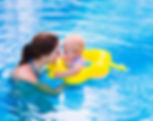 Mother and baby in swimming pool. Parent