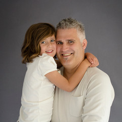 Father and daughter studio portrait