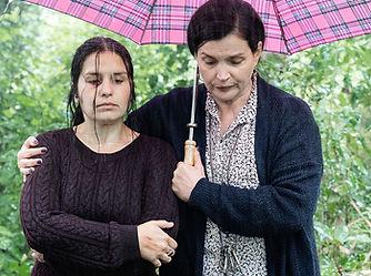 Emma Draper and Julia Ormond in the rain