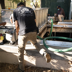 Trouble shooting a second water pump to remove water from the flood service tunnel next to the South Gym.