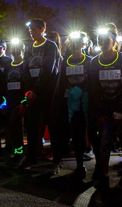 Runners at Start Line with Energizer Hea