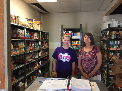 mother and daughter helping at the Eureka Food Pantry