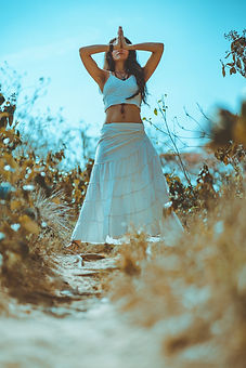 Canva - Woman in a White Top and Skirt.j