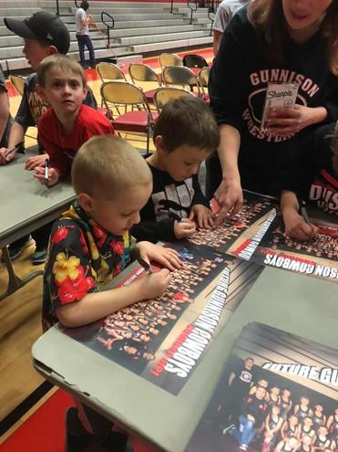 club kids signing autographs