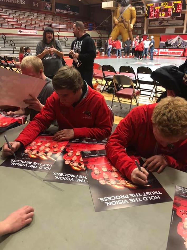 WCU Wrestlers signing autographs