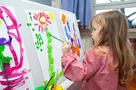 Child painting at Angels Day Nursery