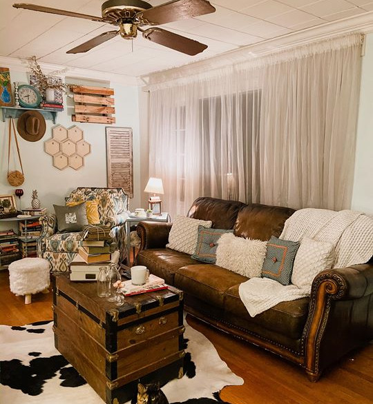 Living Room with Leather Sofa & Cow Hide Rug