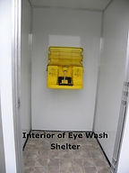 stand alone eyewash station, portable and permanent,  unobstructed access, does not look like a Porta Potty