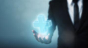 Businessman hand holding plus sign virtu