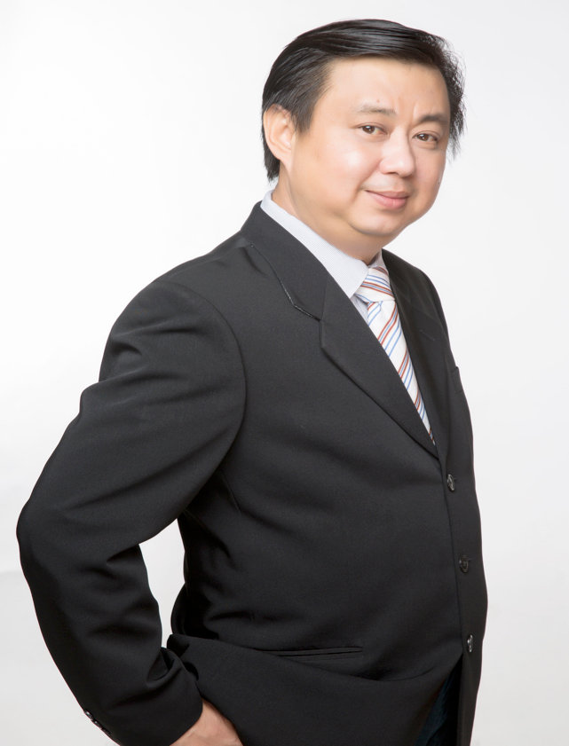 David Ong Suit Pose Hi res.jpg