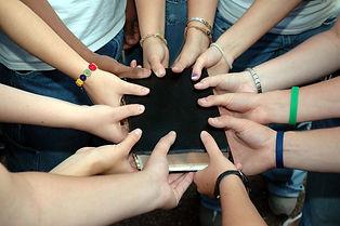 243899-1600x1064-youth-group-holding-bib