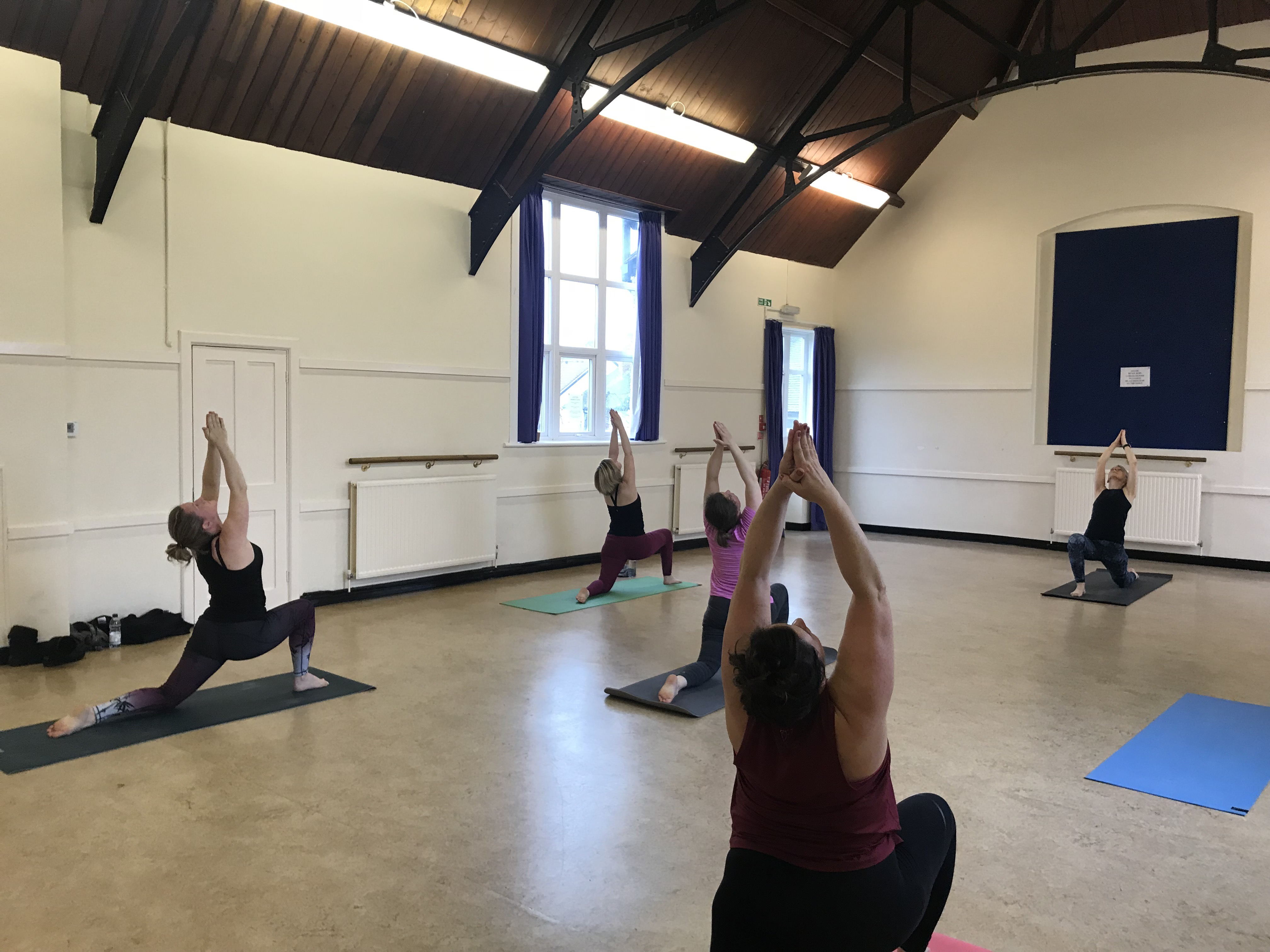 YogaWithVickiB yoga class practicing Crescent Moon pose