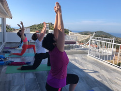 Yoga With VickiB yoga retreat class on terrace overlooking Kalkan Bay