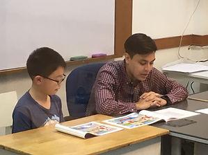 Ryan Cullen conducting a speakaing exam