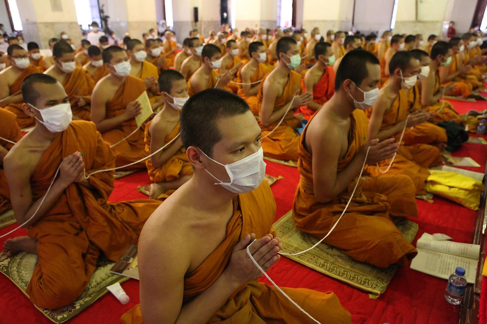 Covid protection for Thai monks praying