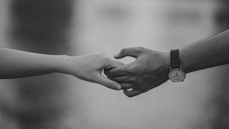 monochrome-photo-of-couple-holding-hands