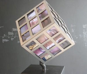 A cube sculpture in the lobby of ESMoA features digital panels revealing uploaded selfies in real time.