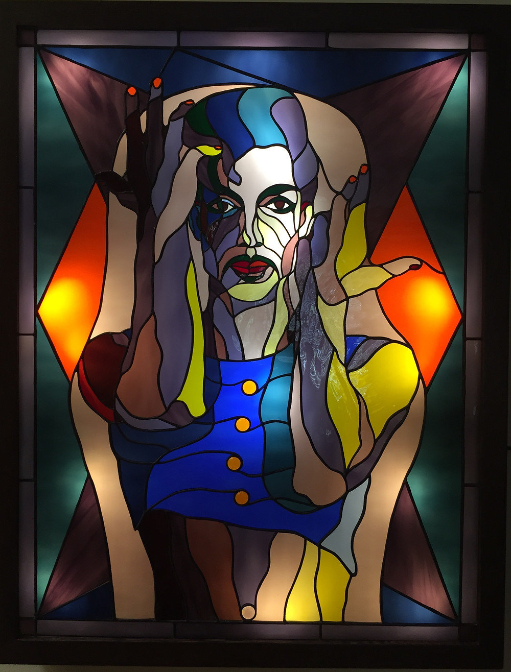 The musician Prince is depicted in colored glass