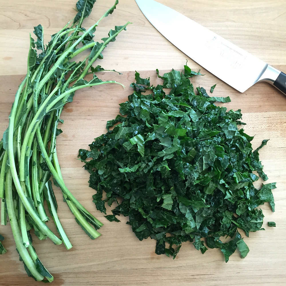 Chef's knife and herbs