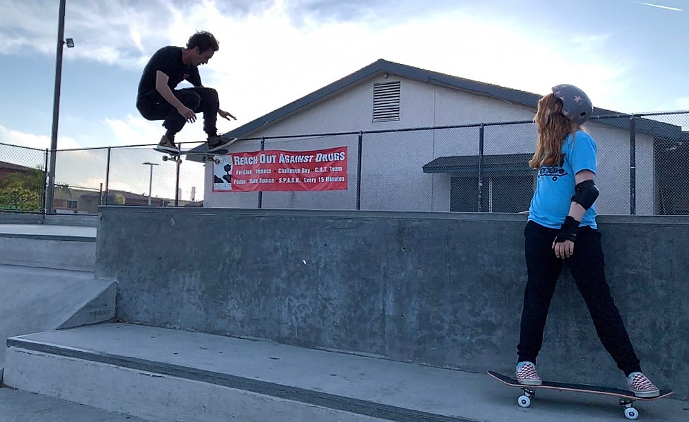 Elliott Wright and a young friend skate at El Segundo Skate Park
