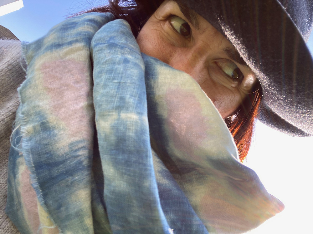 Adriana Ochoa headshot with hand-dyed fabric in foreground