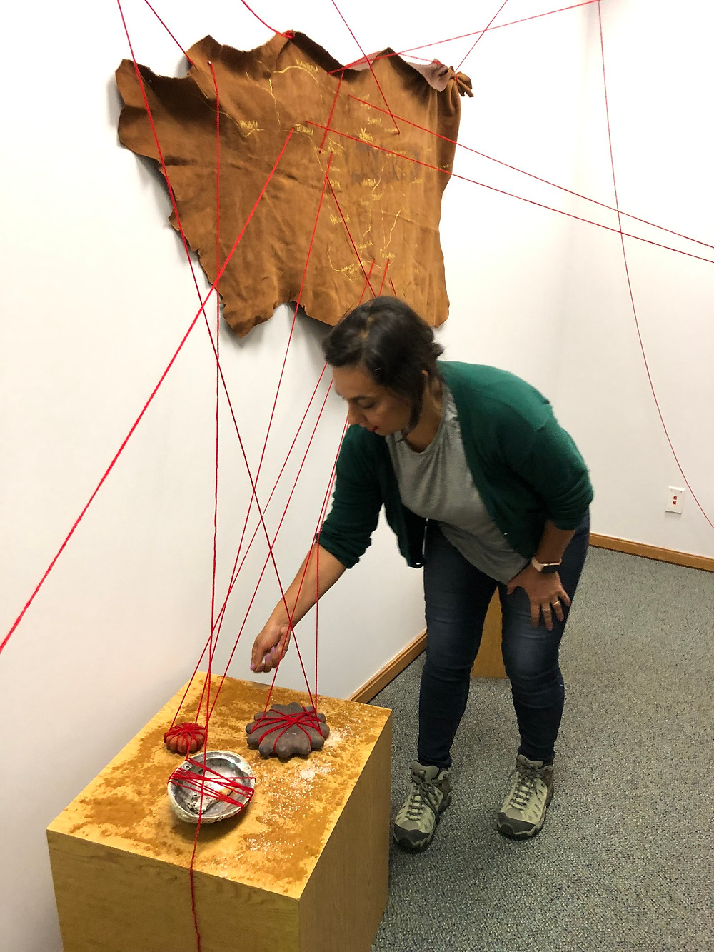 Artist Mercedes Dorame finishes an art installation at El Segundo Public Library