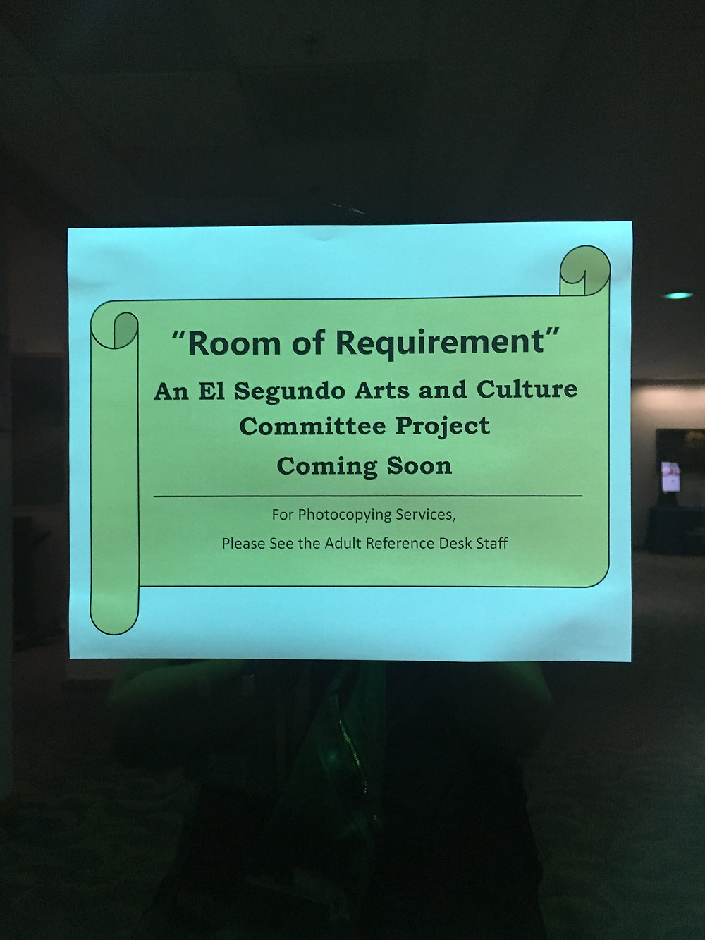 A sign introducing the Room of Requirement is posted on a door at the El Segundo Public Library