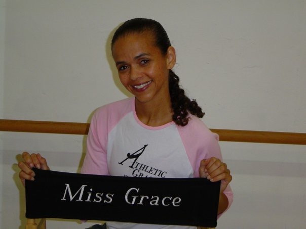 Dance instructor Grace Maxwell seated on a director's chair in her dance studio