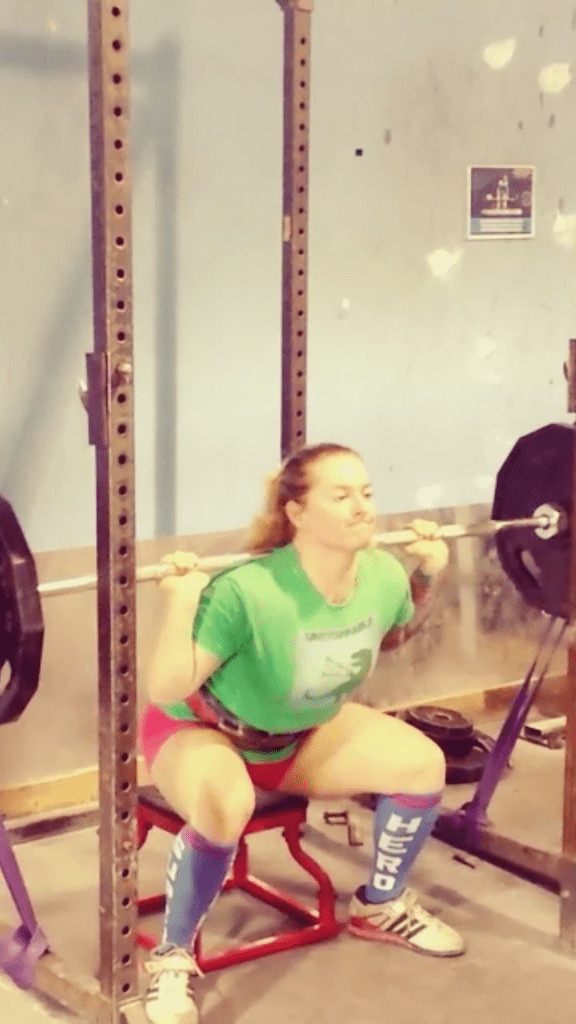 Example of a main assistance lift: banded box squats